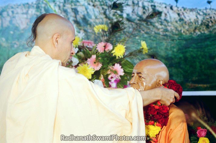 Radhanath Swami Offering garland to diety of srila prabhupad