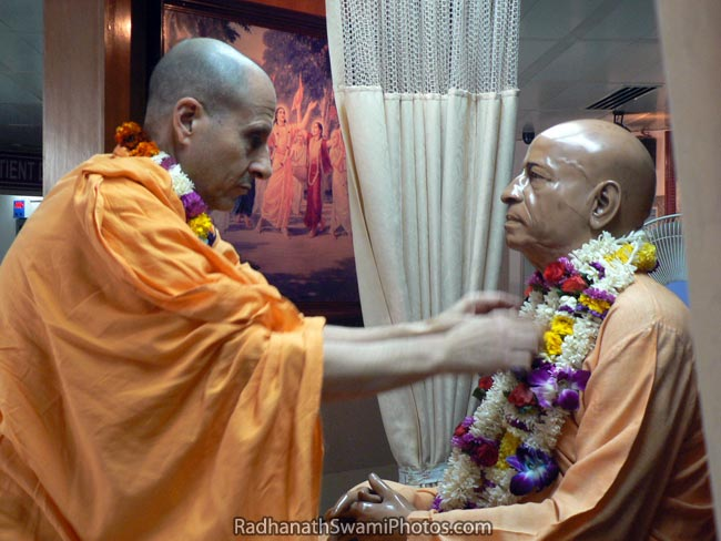 Radhanath Swami Garlanding The Deity Of Srila Prabhupada