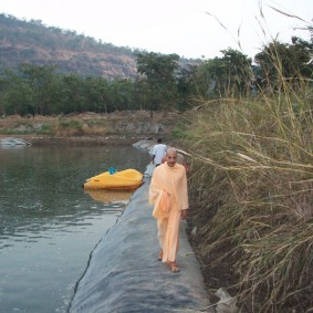 Radhanath Swami near The Lake 283x283 Radhanath Swami In Govardhan Ashram