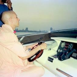 Radhanath Swami driving a Boat