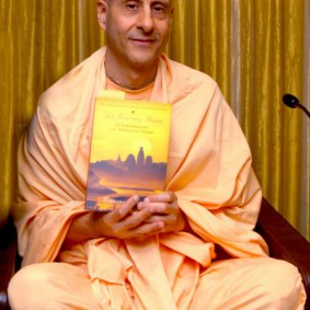 Radhanath Swami holding Journey Home 283x283 Radhanath Swami Special Moments