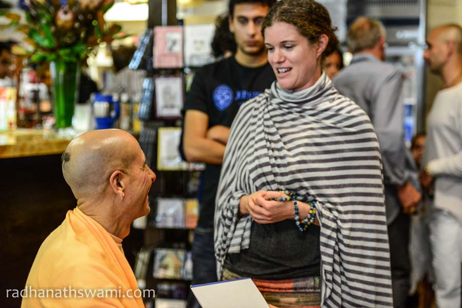 HH Radhanath Swami Signing his book The Journey home