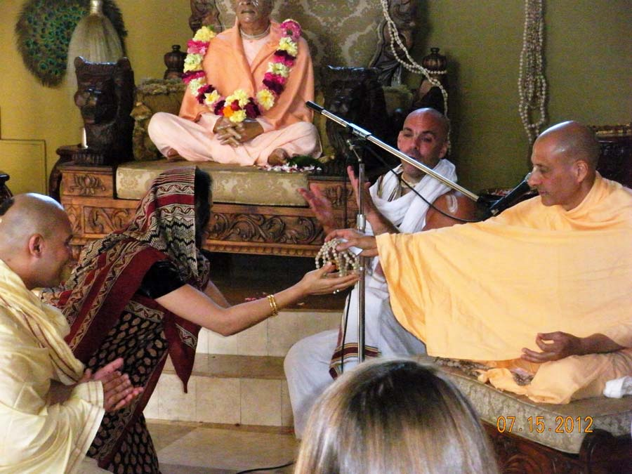 Radhanath Swami giving Initiation to a Devotee