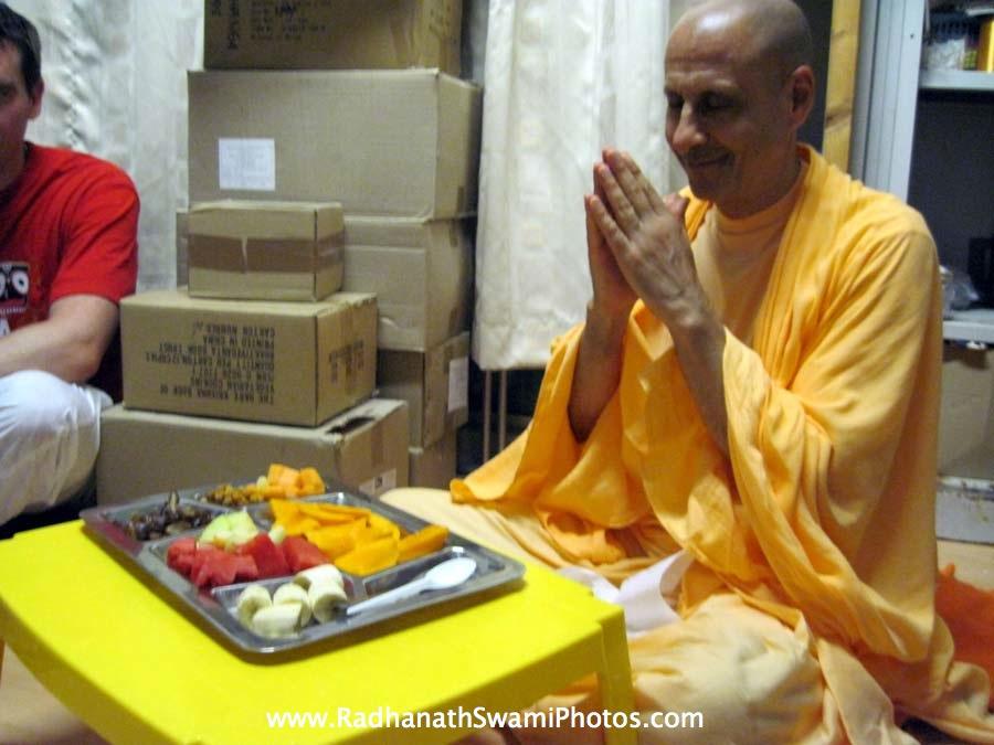 Radhanath Swami Maharaj honouring prasadam