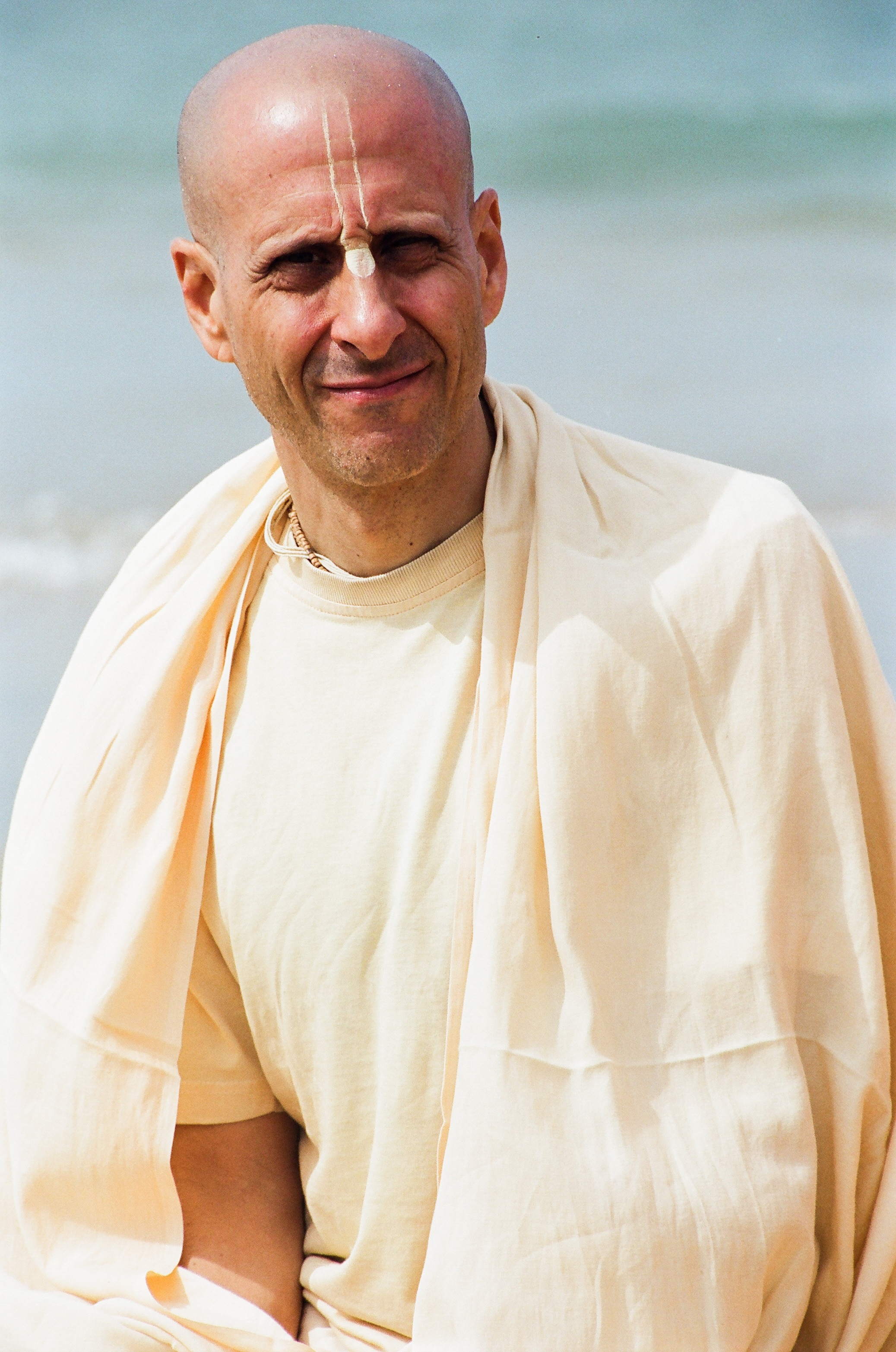 Radhanath Swami Sitting on a Beach during South India Yatra