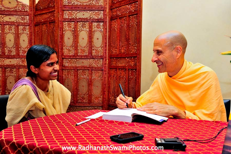 Swami Radhanath Signing his Book The Journey Home