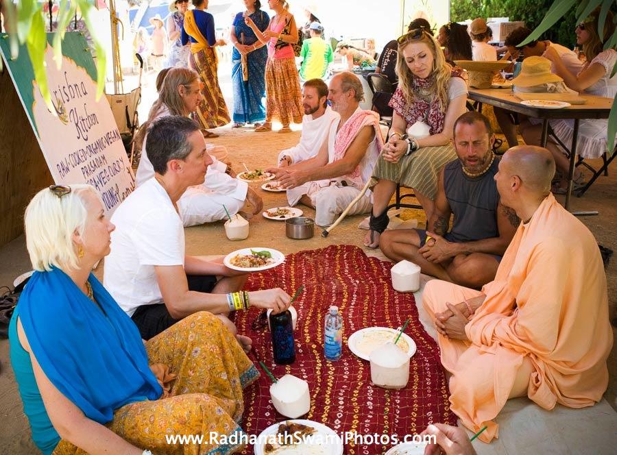 Radhanath Swami honouring Prasadam