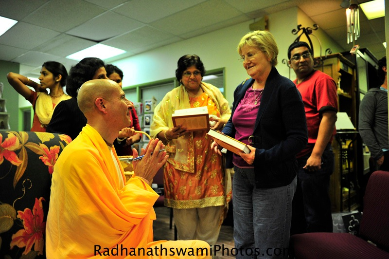 Radhanath Swami signing his book at Akashic Book Store