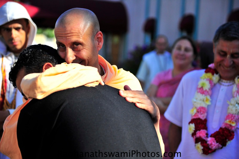 Radhanath Swami embrasing devotee