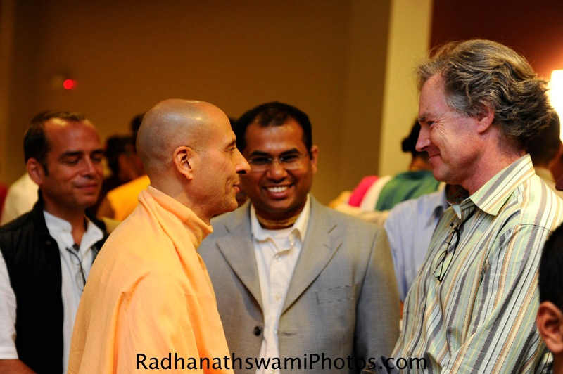 Radhanath Swami speaking to guests at Dance to the dsource of Love event