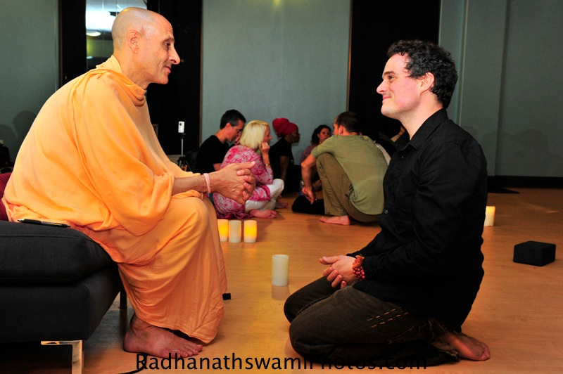 Radhanath Swami speaks with Guest at Core Power Yoga Center