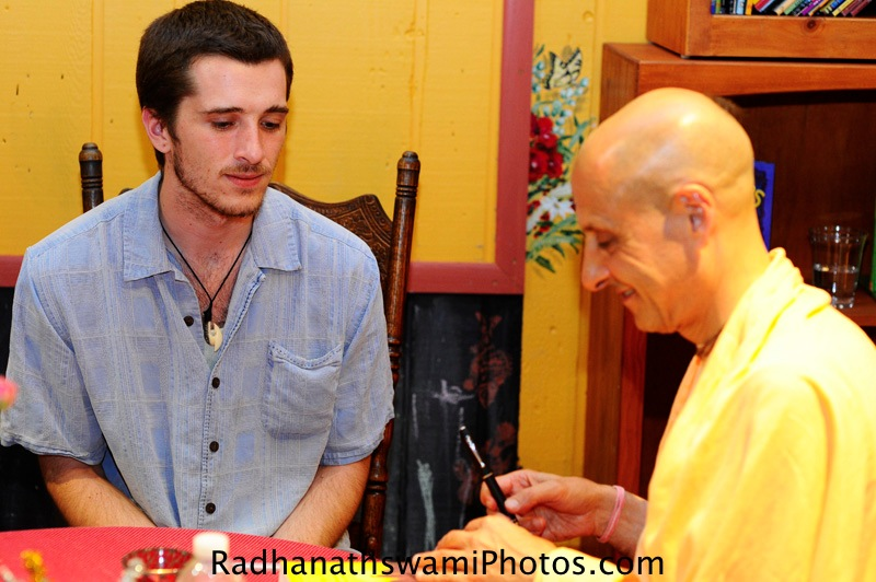 Radhanath Swami signing his Book - The Journey Home