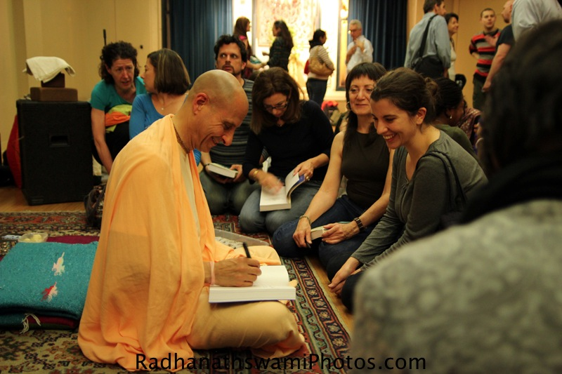 Radhanatha Swami signing his book at Jivamukti Yoga Center
