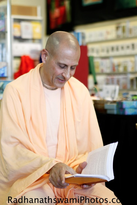 Radhanath Swami reading his book for guests