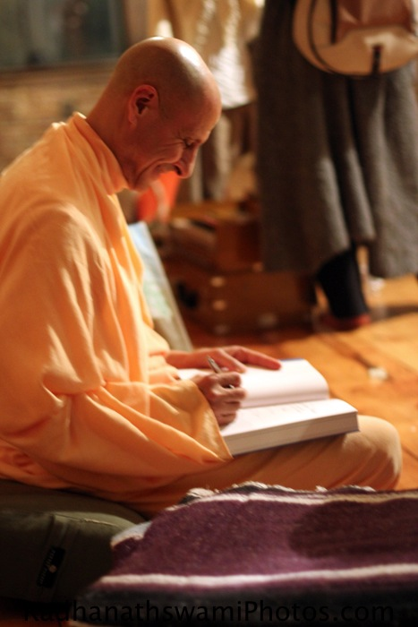 Swami Radhanatha Signing his Book The Journey Home