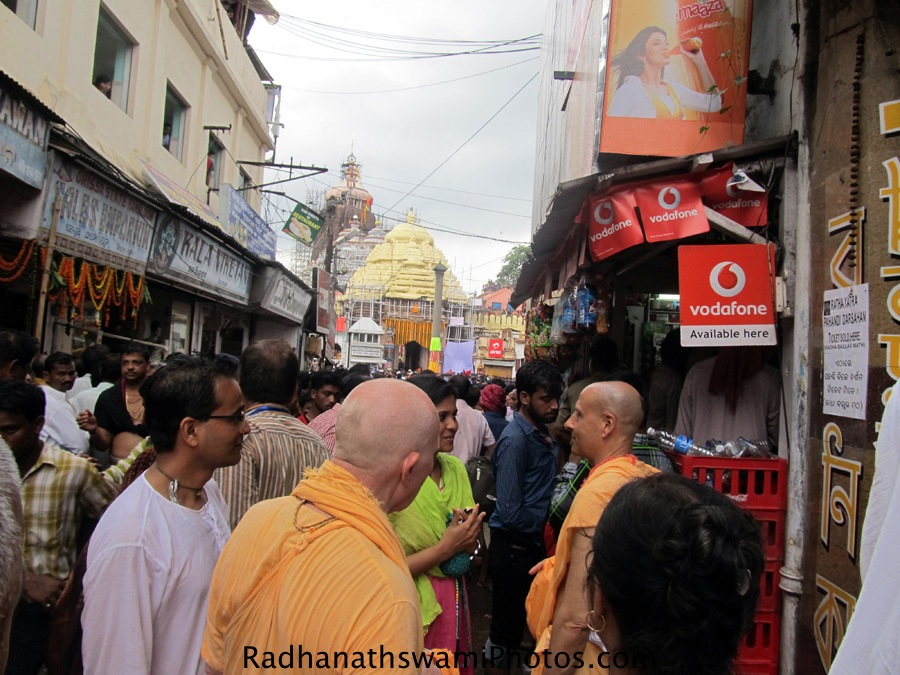 Radhanath Swami speaking to devotee