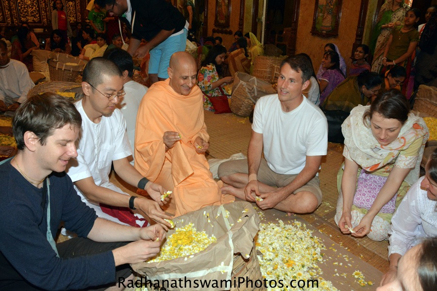 Radhanath Swami plucking flowers for lord-