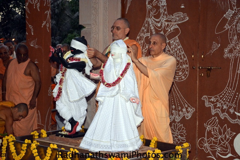 Radhanath Swami and Bhakti vidyapurna Swami opening the eyeband of Deities