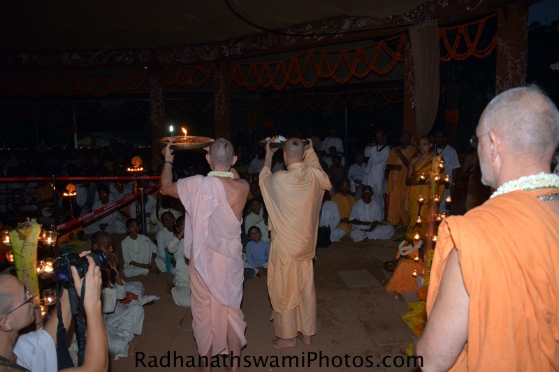 Showing arati to devotees