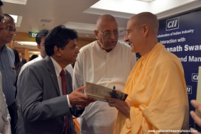 Radhanath Swami signs his book the Journey Home