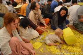A child playing while plucking flowers - Radhanath Swami