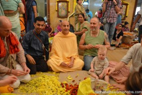 Radhanath Swami and Raghunath while plucking flower petals