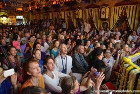 People watching flower abhishek for the dieties - Radhanath Swami