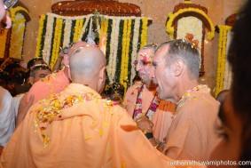 Radhanath Swami, Niranjan Swami, Indradyumna Swami and Giriraj Swami throwing flower petals
