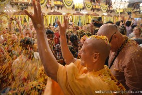Radhanath Swami throwing flower petals