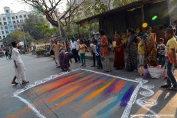 Devotees making rangoli for Lord Jagannath