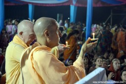 Radhanath Swami and Chandramouli Swami offering lamp to lord damodara