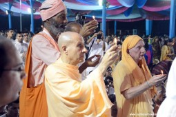 Radhanath Swami offering lamp to Lord Damodara