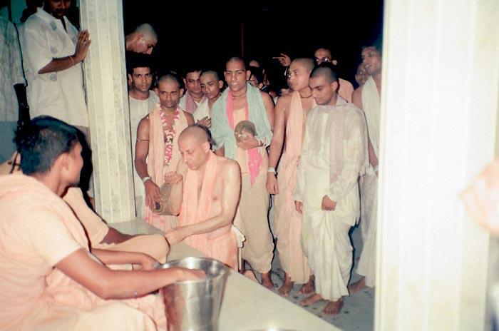 Radhanath Swami Serving Devotees