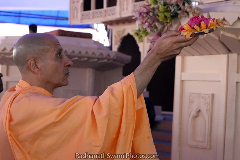 Radhanath Swami Offering Flowers