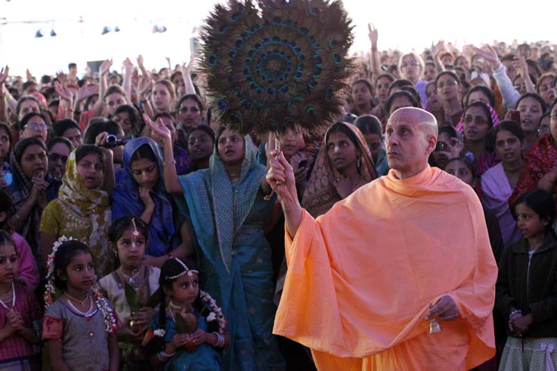 Radhanath Swami Offering Peacock Fan