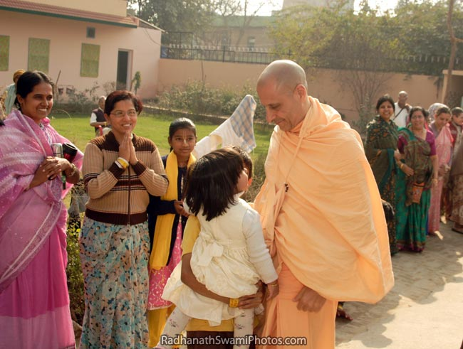 Radhanath Swami Showing His Affection To A Child