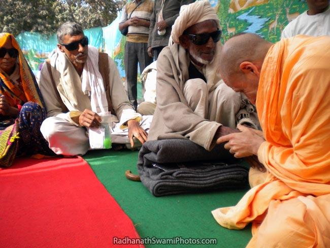 Radhanath Swami Lovingly Holding Patients Hand