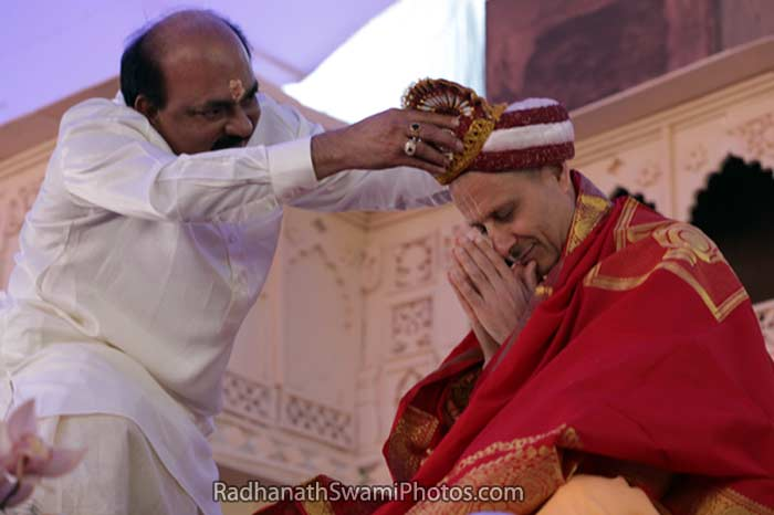 Dr Alva offering a Crown