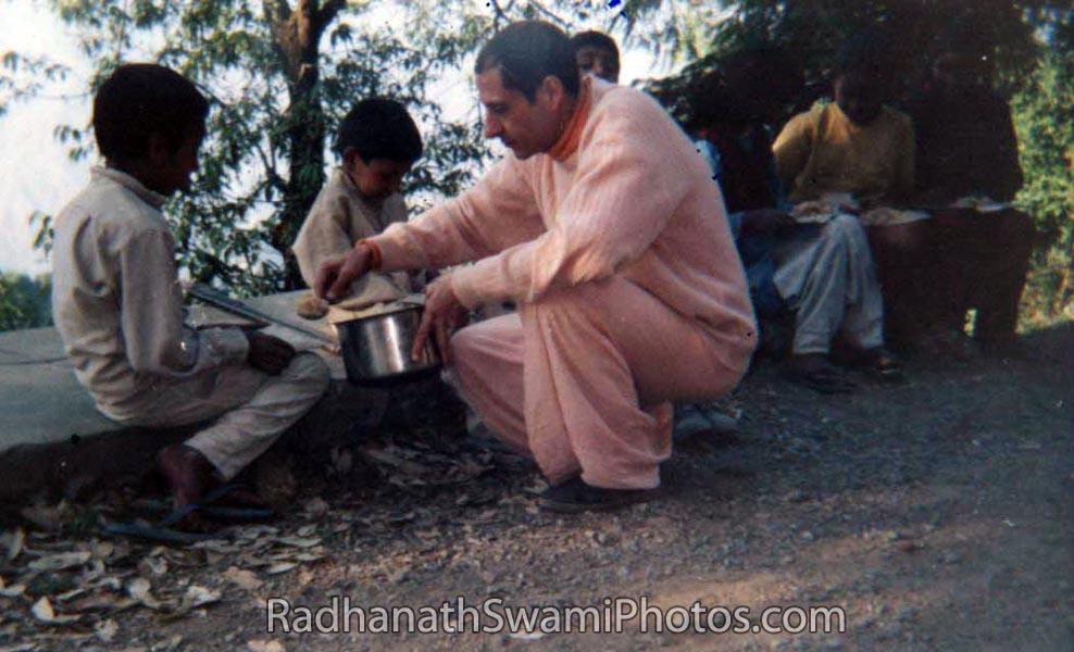 Radhanath Swami Feeding a Small Children