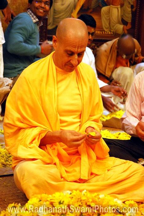 Radhanath Swami Plucking Flower Petals