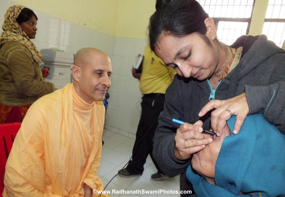 Radhanath Swami Observing Patient being Treated