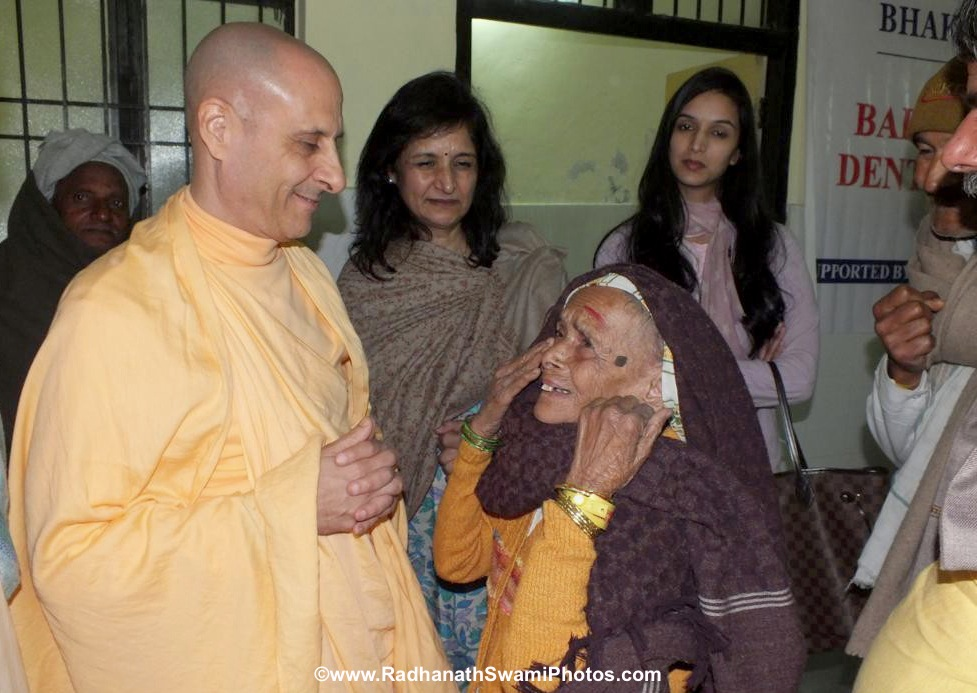 Radhanath Swami talking with patient