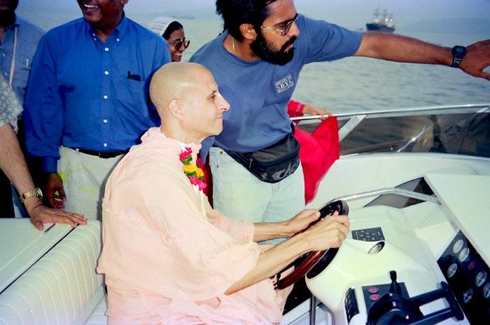 Radhanath Swami Driving Boat