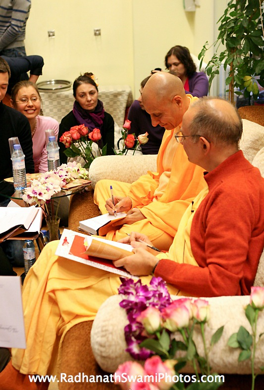 Radhanath Swami Signing Journey Home