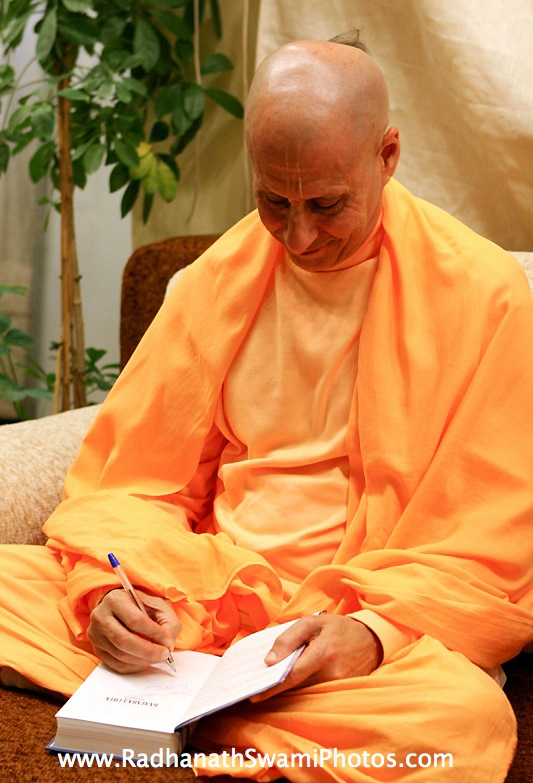 Radhanath Swami Signing his Book journey home