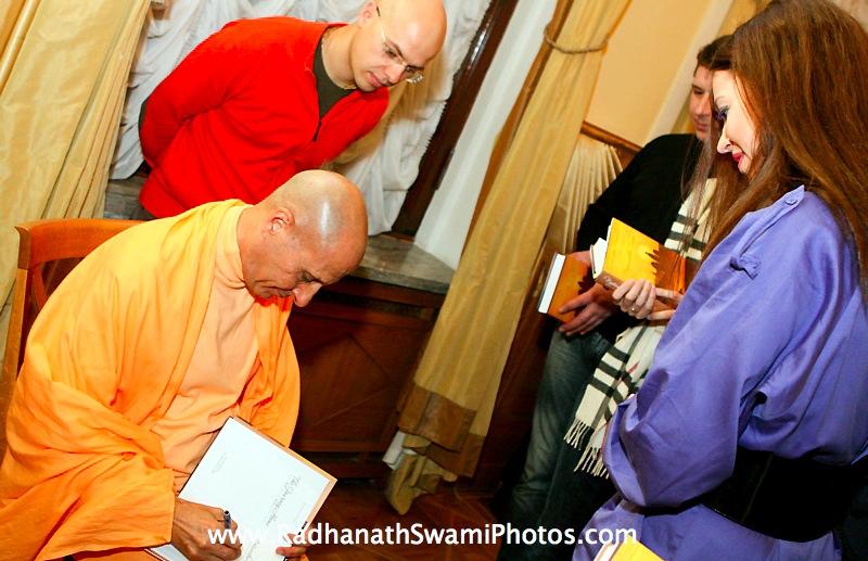 Radhanath Swami Signing his Book