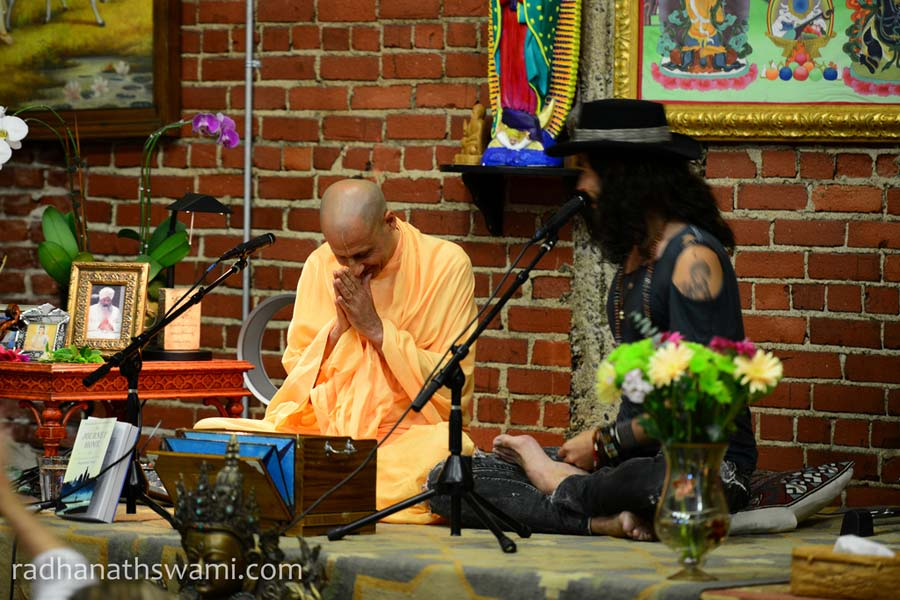 Russell Brand with HH Radhanath Swami in Golden Bridge Yoga