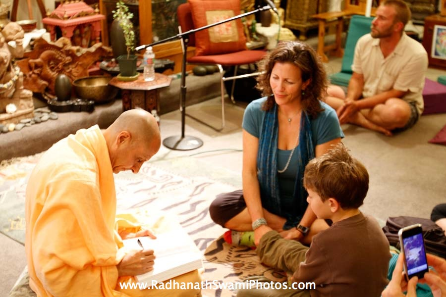 Radhanath Swami Signing his Book at Open Secret Book Store