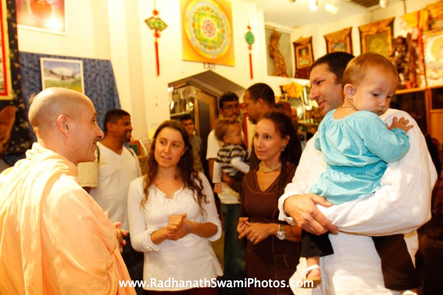 Radhanath Swami speaking with devotees
