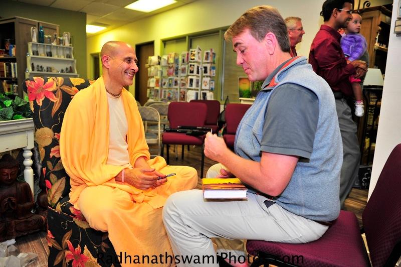 Radhanath Swami talking to Guests
